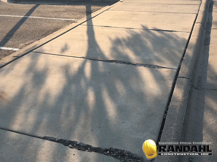 damaged concrete sidewalk